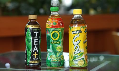 TEA+, Trà xanh Không Độ và C2 là ba thương hiệu đại diện cho Suntory, Tân Hiệp Phát và URC. Ảnh: Anh Tú